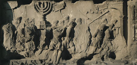 Relief from the Arc of Titus that depicts Roman soldiers sacking the Second Temple in Jerusalem during the second Jewish-Roman War (circa 70 AD). Note that the soldiers are carrying away the Temple's menorah as part of their spoils.